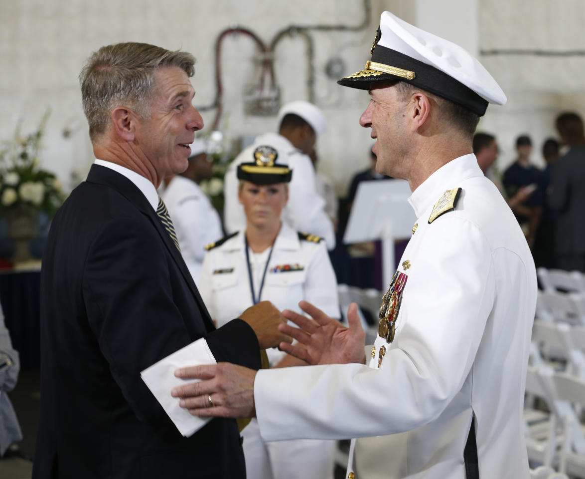 Commander of Naval Operations, Adm. John Richardson, right, speaks to Virginia Congressman Rob Wittman, left, aboard the nuclear aircraft carrier USS Gerald R. Ford prior to it's commissioning at Naval Station Norfolk in Norfolk, Va., Saturday, July 22, 2017. The ship will be commissioned by President Donald Trump later today. (AP Photo/Steve Helber)