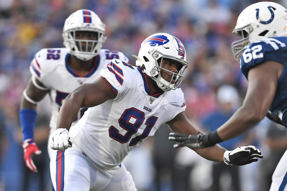 """FILE - In this Aug. 8, 2019, file photo, Buffalo Bills defensive tackle Ed Oliver (91) plays during the first half of an NFL preseason football game against the Indianapolis Colts in Orchard Park, N.Y. If the Buffalo Bills drafted Oliver with the expectation to replace Kyle Williams at defensive tackle, who better than having the just-retired player pop in at training camp and provide the rookie a weeklong crash course. Oliver happily referred to Williams as being his """"cheat code"""" to the NFL. (AP Photo/Adrian Kraus, File)"""