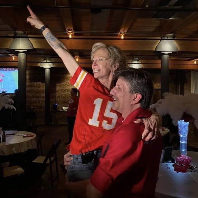 This Kansas City couple got married on Super Bowl Sunday — and celebrated the Chiefs' victory during their reception. (Photo: Courtesy of Nikki Walkowiak)