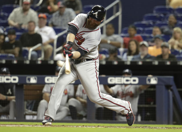 Atlanta Braves' Brian McCann hits a two-run home run during the sixth inning of the team's baseball game against the Miami Marlins, Friday, May 3, 2019, in Miami. (AP Photo/Lynne Sladky)