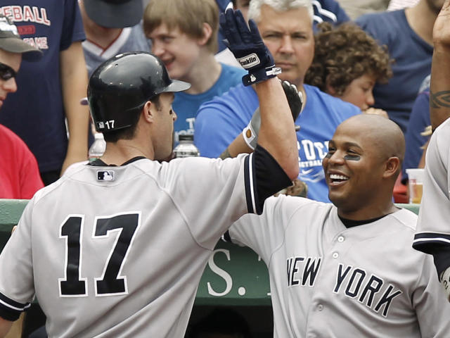 BOSTON, MA - JULY 7: Andruw Jones #22 of the New York Yankees greets Jayson Nix #17 after Nix's home run during the fourth inning of game one of a doubleheader against the Boston Red Sox at Fenway Park on July 7, 2012 in Boston, Massachusetts. (Photo by Winslow Townson/Getty Images)