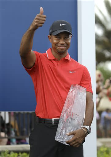 Tiger Woods gives a thumbs-up after winning The Players Championship. (AP)