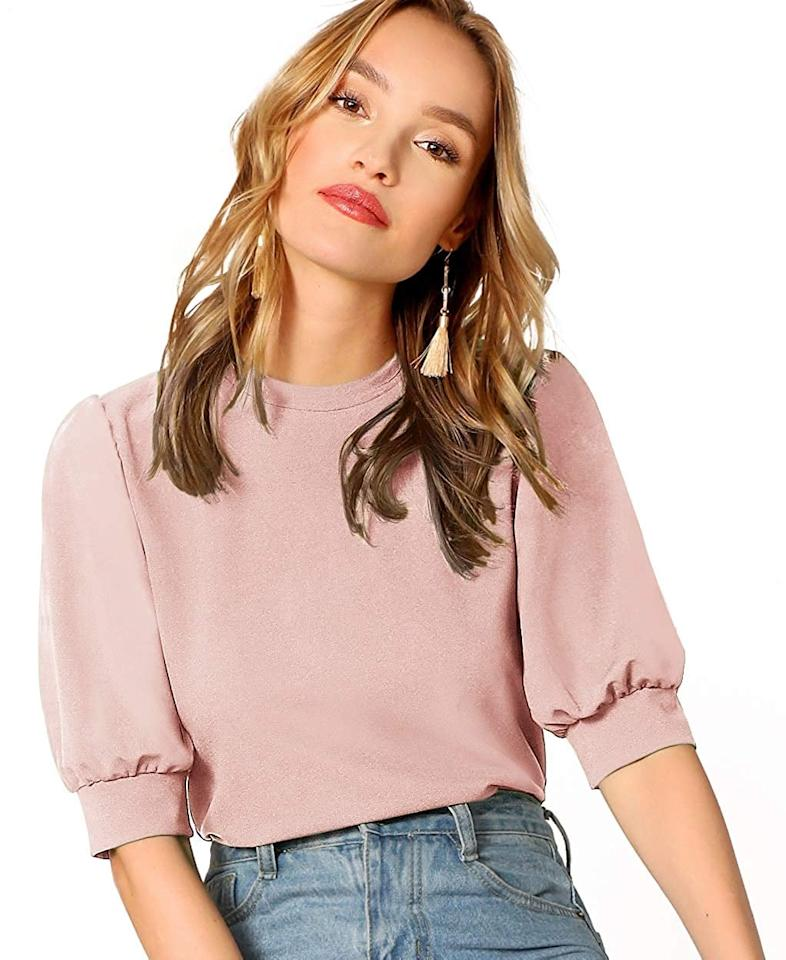 "<p>This top-rated <a href=""https://www.popsugar.com/buy/Shein-Puff-Sleeve-Top-551645?p_name=Shein%20Puff-Sleeve%20Top&retailer=amazon.com&pid=551645&price=26&evar1=fab%3Auk&evar9=47291480&evar98=https%3A%2F%2Fwww.popsugar.com%2Ffashion%2Fphoto-gallery%2F47291480%2Fimage%2F47291624%2FShein-Puff-Sleeve-Top&list1=shopping%2Camazon%2Cspring%20fashion%2Cfashion%20shopping&prop13=api&pdata=1"" rel=""nofollow"" data-shoppable-link=""1"" target=""_blank"" class=""ga-track"" data-ga-category=""Related"" data-ga-label=""https://www.amazon.com/SheIn-Womens-Casual-Sleeve-Green-2/dp/B07SC2VMJ7/ref=sr_1_17_sspa?imprToken=lJxoLc4.oBLYcvwEgJphhg&amp;slotNum=80&amp;creativeASIN=B07T82PF2V&amp;linkCode=w50&amp;tag=popsugarshopx-20&amp;crid=2XXCSTWSZ10H&amp;keywords=work%2Bblouses%2Bfor%2Bwomen&amp;qid=1567026472&amp;s=gateway&amp;sprefix=work%2Bblo%2Caps%2C204&amp;sr=8-17-spons&amp;smid=A4P3419F91RBN&amp;spLa=ZW5jcnlwdGVkUXVhbGlmaWVyPUEzOVJESU80R0ZXTlVYJmVuY3J5cHRlZElkPUEwMDAxNjA4M0YzVk4zVUpaRE5aMyZlbmNyeXB0ZWRBZElkPUEwMTY5MjM3MjZGQ0Y0UE84SzZKWSZ3aWRnZXROYW1lPXNwX210ZiZhY3Rpb249Y2xpY2tSZWRpcmVjdCZkb05vdExvZ0NsaWNrPXRydWU&amp;th=1&amp;psc=1"" data-ga-action=""In-Line Links"">Shein Puff-Sleeve Top</a> ($26) comes in tons of colors.</p>"