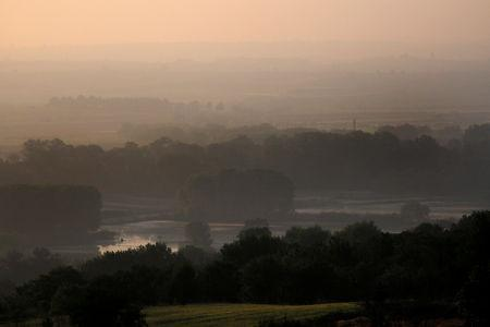 FILE PHOTO: A view of the Evros river, the natural border between Greece and Turkey, with Turkey seen in the background, near the village of Pythio