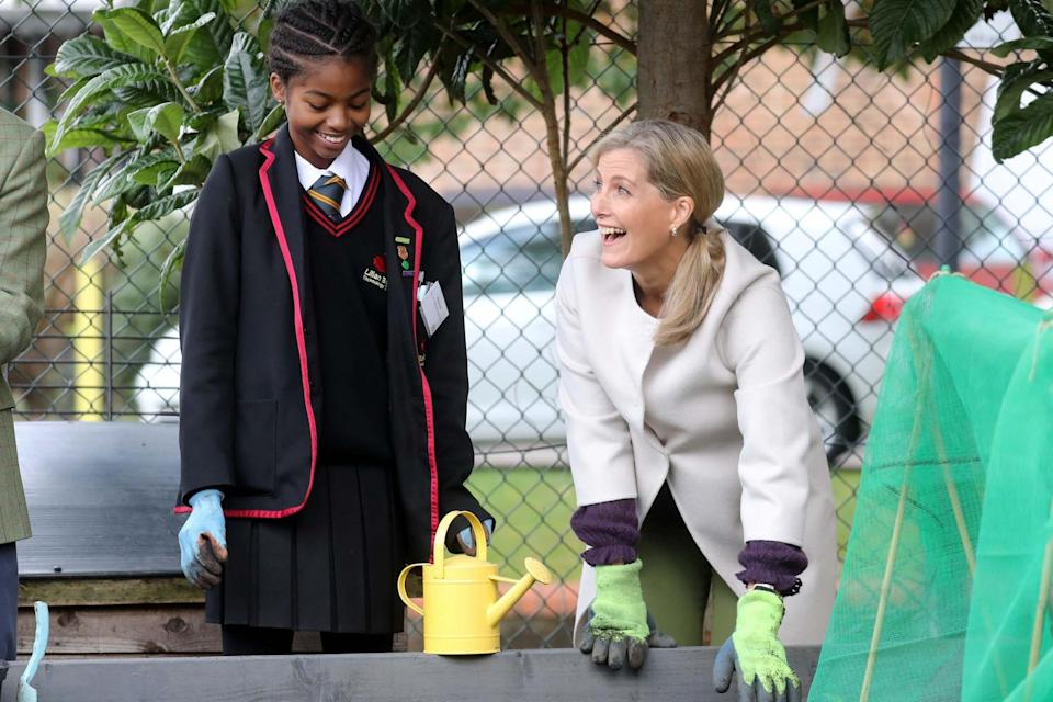 The Countess of Wessex smiles with a schoolgirl during a visit to see Vauxhall City Farm's community engagement and education programmes in action (REUTERS)