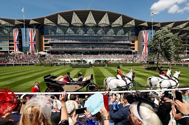 Horse Racing - Royal Ascot - Ascot Racecourse, Ascot, Britain - June 21, 2018 Britain's Queen Elizabeth and Prince Andrew arrive during the carriage procession before the start of the racing Action Images via Reuters/Andrew Boyers