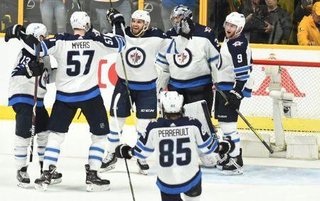 May 10, 2018; Nashville, TN, USA; Winnipeg Jets players celebrate after a win against the Nashville Predators in game seven of the second round of the 2018 Stanley Cup Playoffs at Bridgestone Arena. Mandatory Credit: Christopher Hanewinckel-USA TODAY Sports
