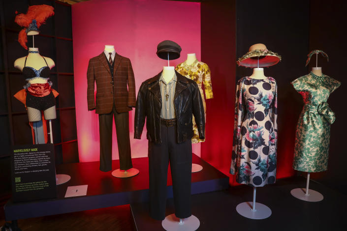 """Costumes from the TV series """"The Marvelous Mrs. Maisel"""" are displayed at the """"Showstoppers! Spectacular Costumes from Stage & Screen"""" exhibit, benefitting the Costume Industry Coalition Recovery Fund, in Times Square on Monday, Aug. 2, 2021, in New York. (Photo by Andy Kropa/Invision/AP)"""
