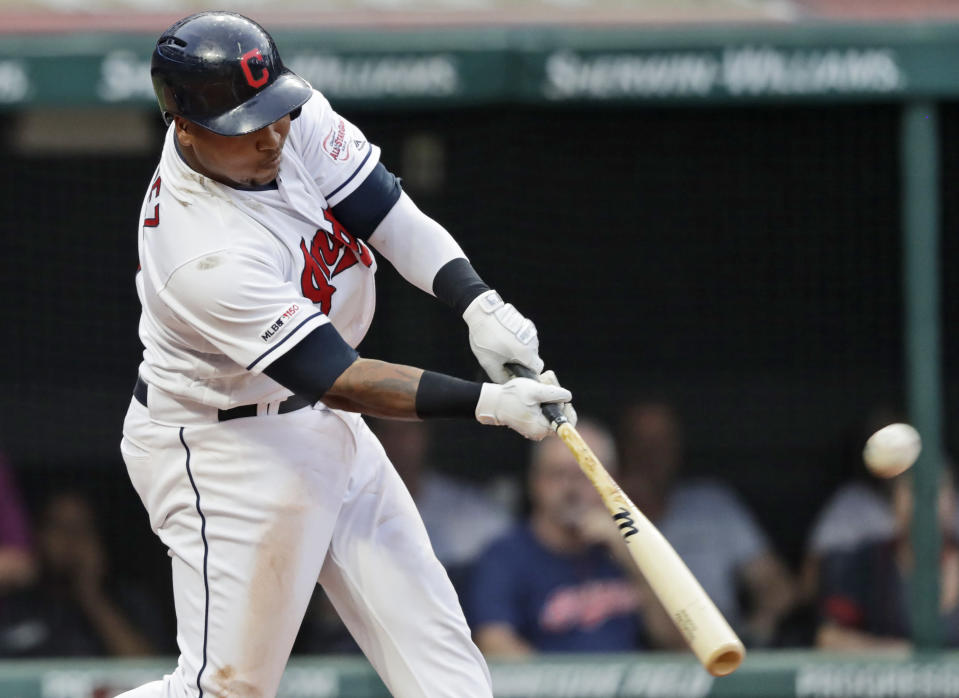 Cleveland Indians' Jose Ramirez hits a three run home run in the third inning in a baseball game against the Boston Red Sox, Monday, Aug. 12, 2019, in Cleveland. Carlos Santana and Franmil Reyes scored on the play. (AP Photo/Tony Dejak)