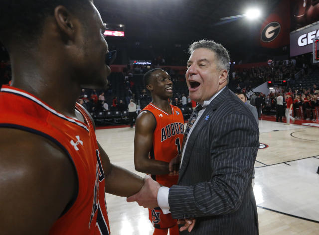 Auburn head coach Bruce Pearl celebrates with guards Davion Mitchell, left, and Jared Harper (1) in the second half of an NCAA college basketball game, Saturday, Feb. 10, 2018, in Athens, Ga. Auburn won 78-61. (AP Photo/John Bazemore)