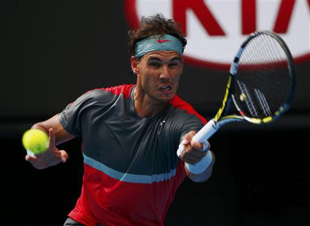 Rafael Nadal of Spain hits a return to Kei Nishikori of Japan during their men's singles match at the Australian Open 2014 tennis tournament in Melbourne January 20, 2014. REUTERS/Petar Kujundzic