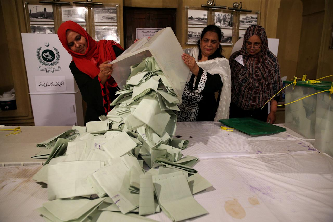 FILE PHOTO: Election officials count ballots after polls closed during the general election in Islamabad, Pakistan, July 25, 2018. REUTERS/Athit Perawongmetha/File Photo