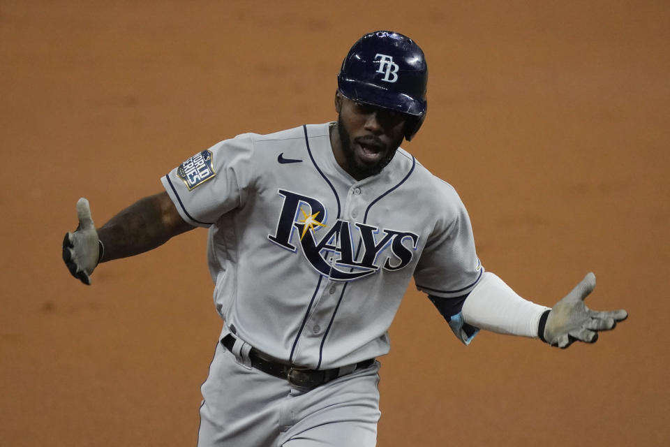 Tampa Bay Rays' Randy Arozarena celebrates a home run during the first inning in Game 6 of the baseball World Series against the Los Angeles Dodgers Tuesday, Oct. 27, 2020, in Arlington, Texas. (AP Photo/Tony Gutierrez)