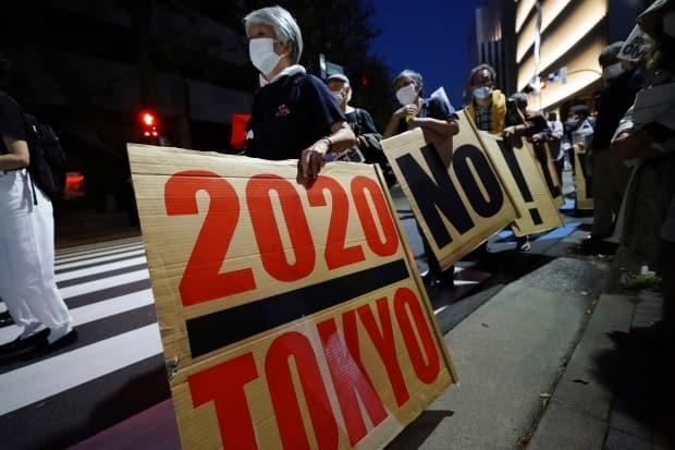 Protesters march around Tokyo's National Stadium during an anti-Olympics protest last month.