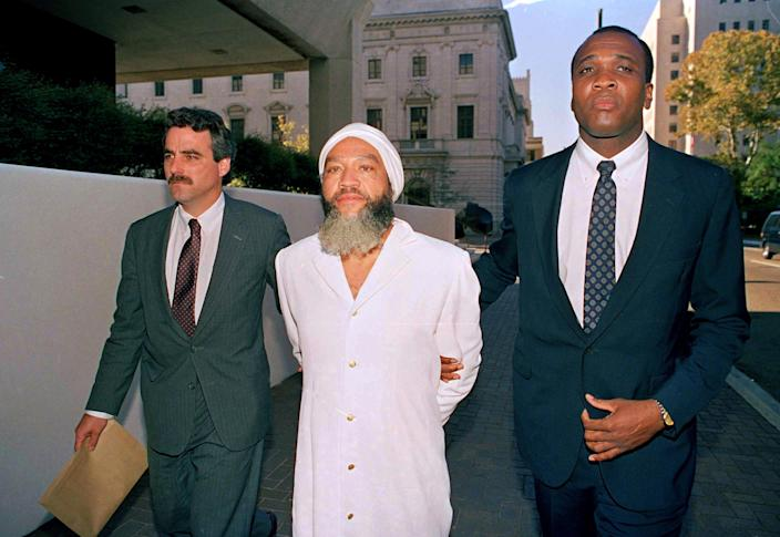 Hulon Mitchell Jr., also known as Yahweh ben Yahweh, is led into the federal court house in New Orleans by FBI agents, Nov. 7, 1990. (Photo: Bill Haber/AP)