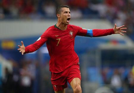 Portugal's Cristiano Ronaldo celebrates scoring their third goal. REUTERS/Hannah McKay