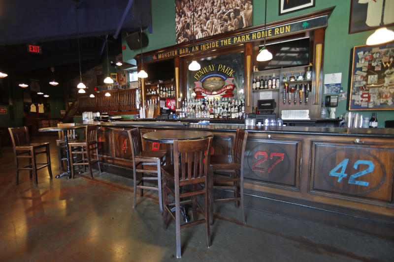 This June 25, 2020, photo shows the interior of the Bleacher Bar in Boston. Tucked under the center field seats at Fenway Park, down some stairs from Lansdowne Street in an area previously used as the visiting team's batting cage, is a sports bar that is preparing to reopen from the coronavirus shutdown. If Major League Baseball's plans remain on schedule, it may be one of the few places fans will be able to watch a game in person this season. (AP Photo/Elise Amendola)