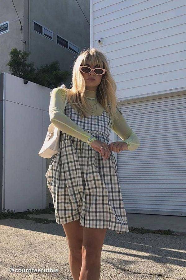 """<p>Layer a colorful tee with this <a href=""""https://www.popsugar.com/buy/UO-Alexia-Plaid-Tie-Shoulder-Babydoll-Dress-481237?p_name=UO%20Alexia%20Plaid%20Tie-Shoulder%20Babydoll%20Dress&retailer=urbanoutfitters.com&pid=481237&price=59&evar1=fab%3Aus&evar9=46509799&evar98=https%3A%2F%2Fwww.popsugar.com%2Ffashion%2Fphoto-gallery%2F46509799%2Fimage%2F46509932%2FUO-Alexia-Plaid-Tie-Shoulder-Babydoll-Dress&list1=shopping%2Cfall%20fashion%2Cback%20to%20school%2Cfall&prop13=mobile&pdata=1"""" rel=""""nofollow"""" data-shoppable-link=""""1"""" target=""""_blank"""" class=""""ga-track"""" data-ga-category=""""Related"""" data-ga-label=""""https://www.urbanoutfitters.com/shop/uo-alexia-plaid-tie-shoulder-babydoll-dress?category=womens-new-arrivals&amp;color=009&amp;type=REGULAR"""" data-ga-action=""""In-Line Links"""">UO Alexia Plaid Tie-Shoulder Babydoll Dress</a> ($59).</p>"""