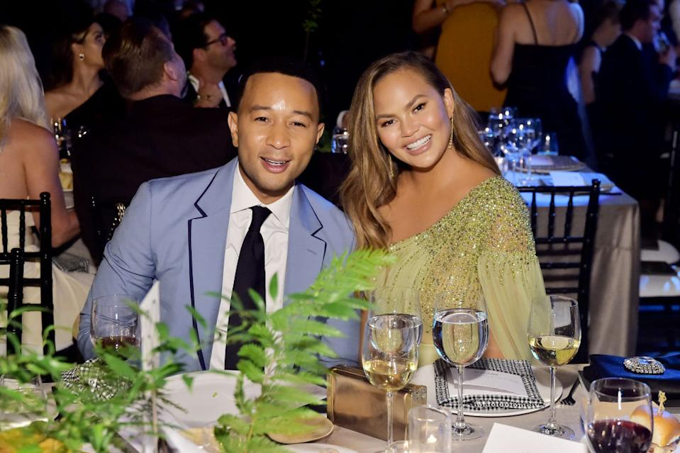 Chrissy Teigen is getting her breast implants removed, pictured with husband John Legend at the Baby2Baby Gala, November 2019. (Getty Images)