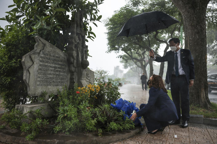 U.S. Vice President Kamala Harris lays flowers at the Senator John McCain memorial site, where his Navy aircraft was shot down by the North Vietnamese, on the three-year anniversary of his death, in Hanoi, Vietnam, Wednesday, Aug. 25, 2021. (Evelyn Hockstein/Pool Photo via AP)