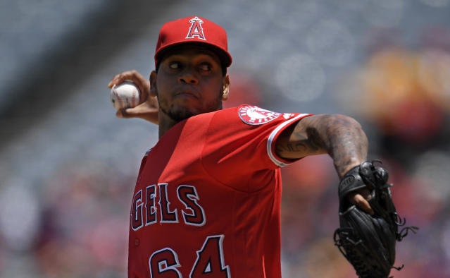 Los Angeles Angels starting pitcher Felix Pena throws to the plate during the first inning of a baseball game against the Toronto Blue Jays, Sunday, June 24, 2018, in Anaheim, Calif. (AP Photo/Mark J. Terrill)