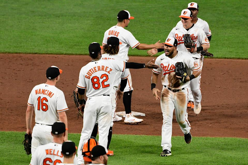 The Baltimore Orioles celebrate after defeating the Los Angeles Angels on Wednesday night.