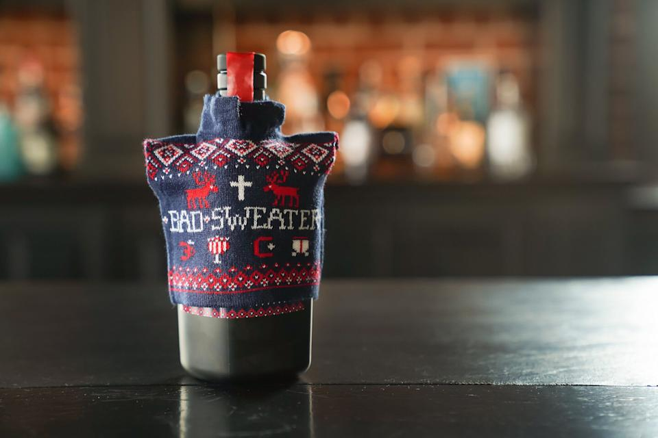 """Why should ugly holiday sweaters be limited to sentient beings? This <a href=""""https://www.savageandcooke.com/spirits/bad-sweater/"""" target=""""_blank"""" rel=""""noopener noreferrer"""">4-year-old bourbon</a> is spiked with holiday spices like cinnamon, nutmeg, clove, cacao nibs and vanilla bean, and comes with its own ugly sweater. Drink up!"""