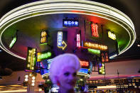 People attend a party during the the opening night of the Resorts World Las Vegas hotel-casino, Thursday, June 24, 2021, in Las Vegas. (AP Photo/John Locher)