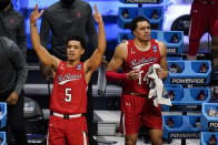 Texas Tech guard Micah Peavy (5) and forward Marcus Santos-Silva (14) celebrate on the bench in the second half against Arkansas of a second-round game in the NCAA men's college basketball tournament at Hinkle Fieldhouse in Indianapolis, Sunday, March 21, 2021. (AP Photo/Michael Conroy)