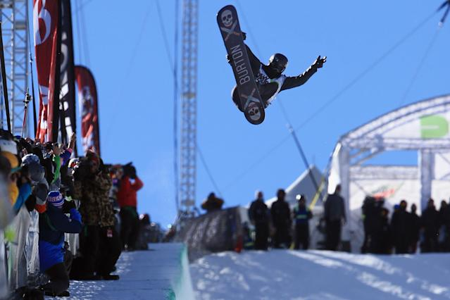 BRECKENRIDGE, CO - DECEMBER 14: Shaun White in action during his second run as he finished second in the men's snowboard superpipe final at the Dew Tour iON Mountain Championships on December 14, 2013 in Breckenridge, Colorado. (Photo by Doug Pensinger/Getty Images)