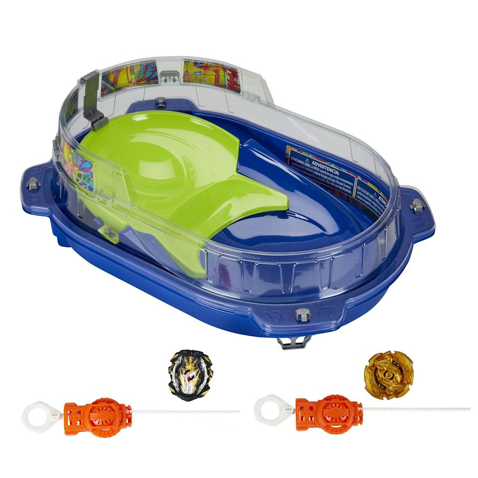 """<p><strong>Beyblade</strong></p><p>walmart.com</p><p><strong>$49.67</strong></p><p><a href=""""https://go.redirectingat.com?id=74968X1596630&url=https%3A%2F%2Fwww.walmart.com%2Fip%2F198760789&sref=https%3A%2F%2Fwww.bestproducts.com%2Fparenting%2Fg34074265%2Fwalmart-top-toys-of-2020%2F"""" rel=""""nofollow noopener"""" target=""""_blank"""" data-ylk=""""slk:Shop Now"""" class=""""link rapid-noclick-resp"""">Shop Now</a></p><p>Calling all Beyblade experts to the arena! This battle set has everything your child needs to go toe-to-toe with an opponent in the rink. This customizable set allows your child to play their way, while the accompanying Beyblade app allows them to spin digitally. </p>"""