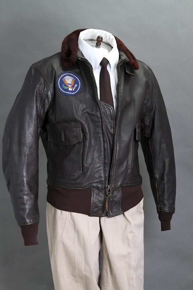 <p>The former President's Air Force One leather bomber jacket fetched more than $500,000 USD (£370,000). The jacket went o an anonymous bidder and was only expected to collect from £13,000 to £26,000 (PA)</p>
