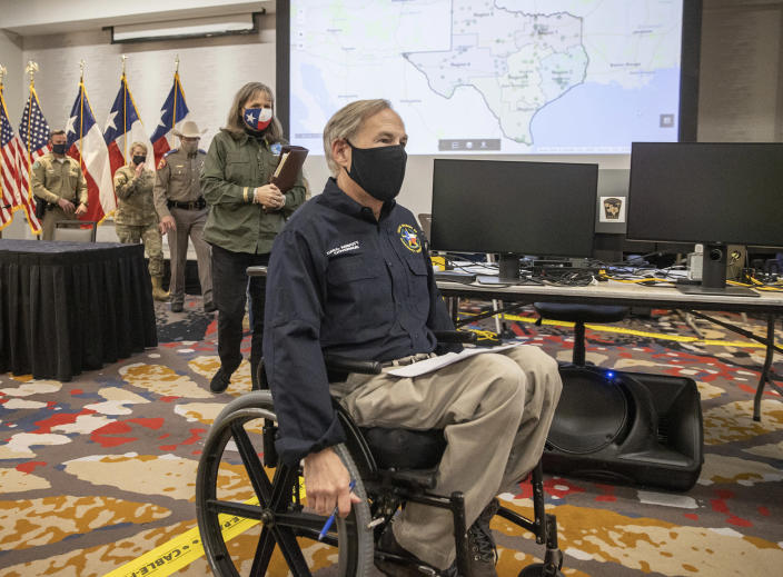Texas Gov. Greg Abbott leaves a news conference after speaking about the winter storm at the State Operations Center, Thursday Feb. 18, 2021, in Austin, Texas. ( Jay Janner/Austin American-Statesman via AP)