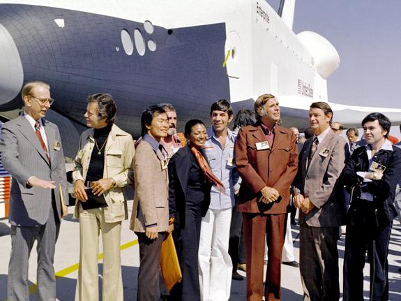 In 1976, NASA's space shuttle Enterprise rolled out of the Palmdale manufacturing facilities and was greeted by NASA officials and cast members from the 'Star Trek' television series. From left to right they are: NASA Administrator Dr. James D.