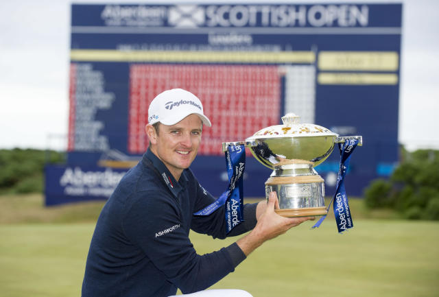 Justin Rose with the Scottish Open Trophy after winning the Scottish Open at Royal Aberdeen, Aberdeen, Scotland, Sunday July 13, 2014. (AP Photo/PA, Kenny Smith)