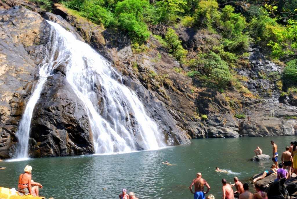 "<b>10.	Dudhsagar Goa </b><br><br>One of the best views of the Dudhsagar Falls is from a train. However, I would recommend the journey across the wild Mollem National Park where you would need to cross two full-bodied rivers. This is where the Mandovi River plunges from a height of 600 metres, forming a milky cascade on the Karnataka-Goa border. The entire setting looks out of the world though. A dense forest hemmed in with rocks while little streams and rivulets flows around them. Tiny wooden bridges sprout in the middle of nowhere. The scene is a dramatic riot of colours with people swimming in a massive pool of blue-green waters rimmed with creamy white foam. Take a dip and refresh yourself in the milky waters that the give the falls its name.<br><br>ALSO SEE: <a target=""_blank"" href=""https://in.lifestyle.yahoo.com/photos/monsoon-magic-a-railway-trek-to-dudhsagar-falls-slideshow/"">A Railway Trek to Dudhsagar Falls</a>"