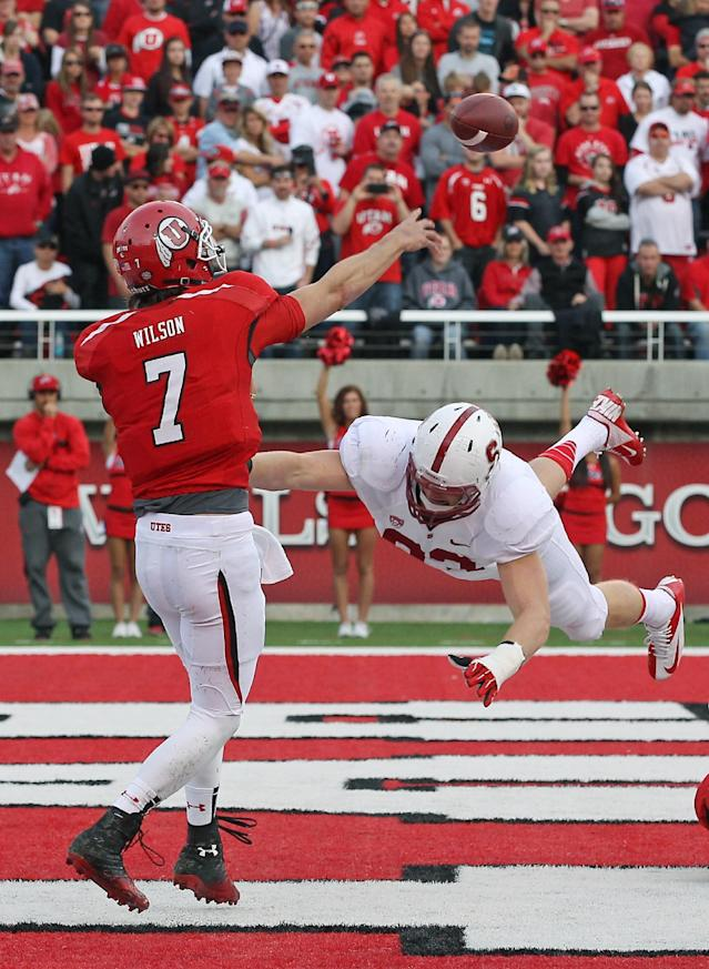 Utah quarterback Travis Wilson (7) passes the ball as Stanford linebacker Trent Murphy, right, dives for him during the second half of an NCAA college football game on Saturday, Oct. 12, 2013, in Salt Lake City. (AP Photo/Rick Bowmer)