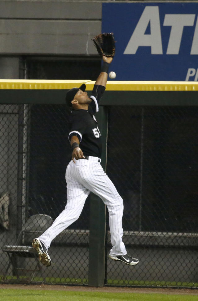 Chicago White Sox right fielder Alex Rios is unable to catch a long fly ball, scoring Salvador Perez, off the bat of Kansas City Royals' Mike Moustakas during the ninth inning of a baseball game on Friday, July 26, 2013, in Chicago. (AP Photo/Charles Rex Arbogast)