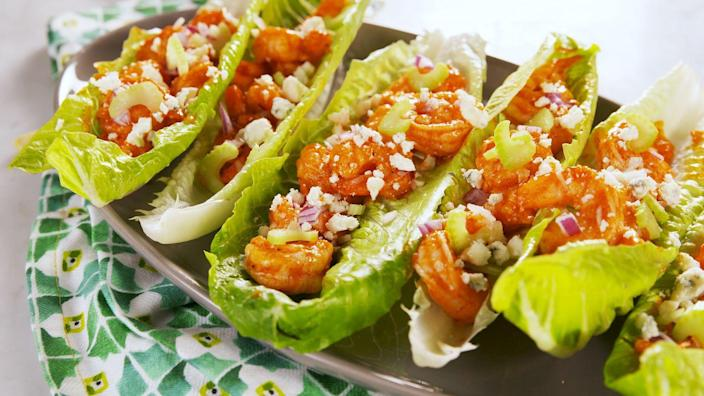 """<p>These may not *technically* be buffalo chicken, but this shrimp-twist on lettuce wraps are heavenly! </p><p>Get the recipe from <a href=""""https://www.delish.com/cooking/a26331032/buffalo-shrimp-lettuce-wraps-recipe/"""" rel=""""nofollow noopener"""" target=""""_blank"""" data-ylk=""""slk:Delish"""" class=""""link rapid-noclick-resp"""">Delish</a>.</p>"""