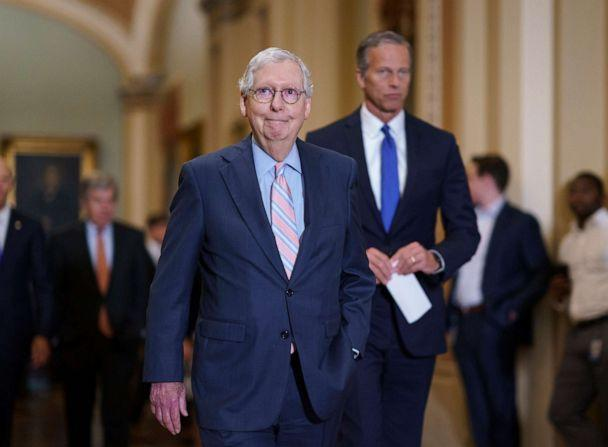 PHOTO: Senate Minority Leader Mitch McConnell, joined at right by Minority Whip John Thune, arrives to speak to reporters at the Capitol in Washington, July 13, 2021, following a weekly GOP strategy meeting. (J. Scott Applewhite/AP, FILE)