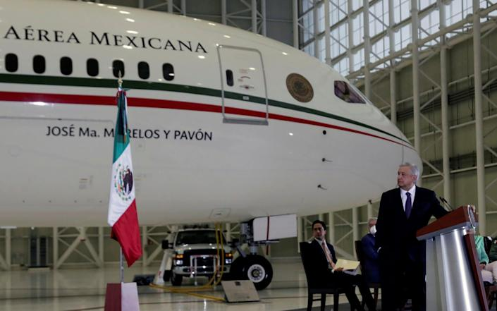 Andres Manuel Lopez Obrador holds a news conference at the presidential hangar