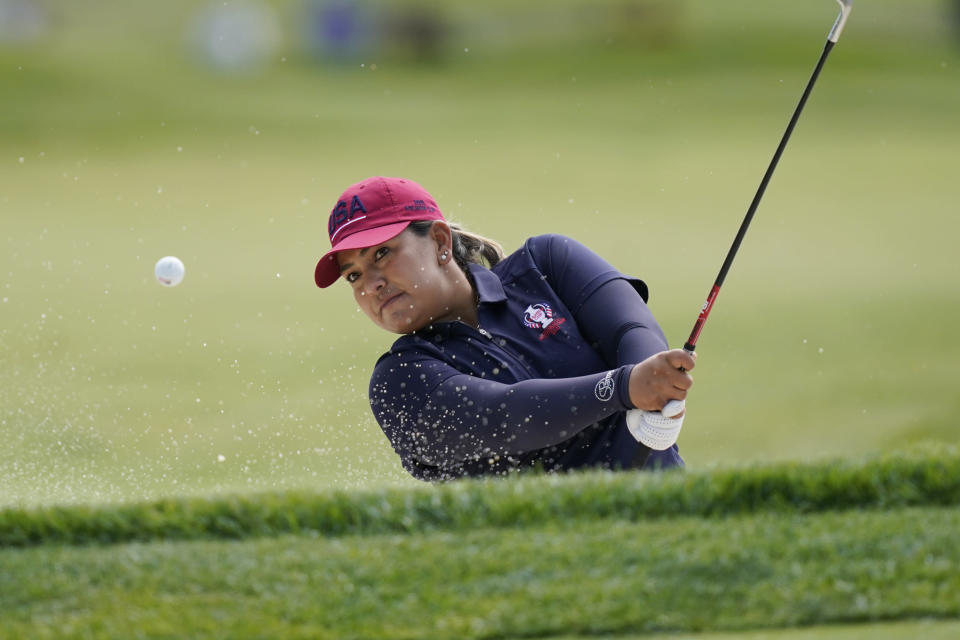 United States' Lizette Salas hits from the sand onto the 18th green during practice for the Solheim Cup golf tournament, Friday, Sept. 3, 2021, in Toledo, Ohio. (AP Photo/Carlos Osorio)