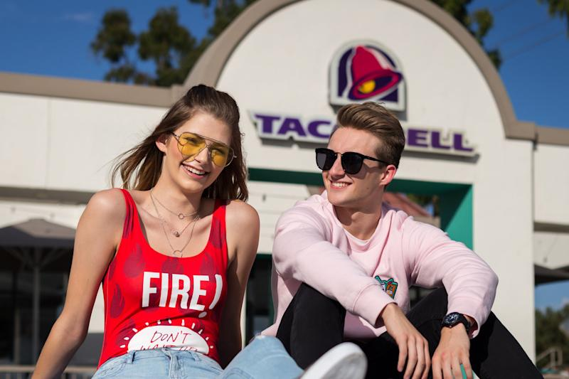 "Models for the new <a href=""https://ec.yimg.com/ec?url=http%3a%2f%2fwww.refinery29.com%2f2017%2f09%2f174135%2ftaco-bell-forever-21-collaboration%26quot%3b&t=1519483130&sig=nvVS3NLoZFocfr.moe4_.g--~D target=""_blank"">Forever 21 x Taco Bell collection</a> include <a href=""https://www.huffingtonpost.com/entry/teen-gets-her-senior-photos-taken-at-taco-bell_us_55c8a478e4b0f73b20b9d3bb"" target=""_blank"">Brittany Creech</a> and <a href=""https://www.huffingtonpost.com/entry/taco-bell-senior-portraits_us_5925c86de4b0650cc0213ed2"">Andrew McBurnie</a>, both of whom <a href=""https://www.huffingtonpost.com/entry/teen-gets-her-senior-photos-taken-at-taco-bell_us_55c8a478e4b0f73b20b9d3bb"">famously took their senior portraits</a> at Taco Bell. (Taco Bell)"