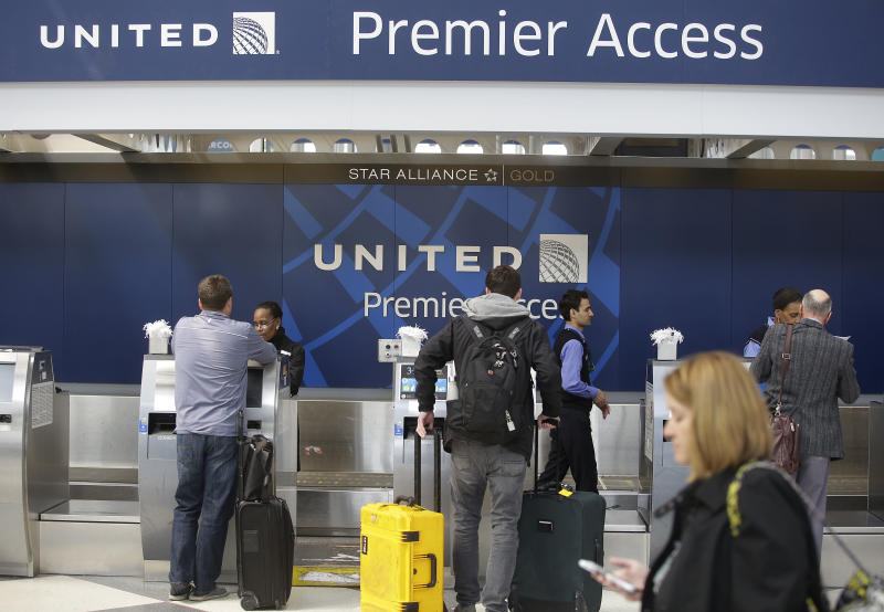 Travelers check in at a United Airlines counter at O'Hare International Airport in Chicago. The violent removal of a doctor from a United flight in Chicago in April was investigated by federal officials. (JOSHUA LOTT via Getty Images)