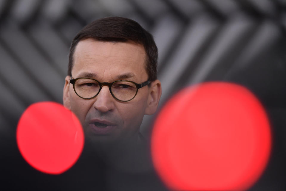 Poland's Prime Minister Mateusz Morawiecki speaks as he arrives for an EU summit at the European Council building in Brussels, Thursday, Dec. 10, 2020. European Union leaders meet for a year-end summit that will address anything from climate, sanctions against Turkey to budget and virus recovery plans. Brexit will be discussed on the sidelines. (John Thys, Pool via AP)