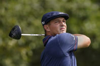 Bryson DeChambeau hits from the tee on the third hole during second round play in the Tour Championship golf tournament at East Lake Golf Club, Friday, Sept. 3, 2021, in Atlanta. (AP Photo/Brynn Anderson)