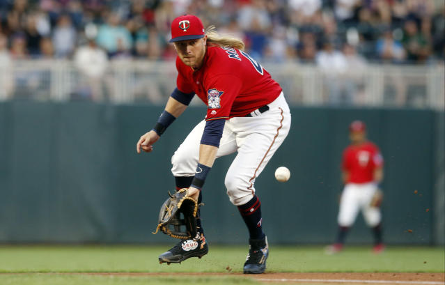 Minnesota Twins third baseman Taylor Motter fields a grounder on a single by Texas Rangers' Elvis Andrus during the fourth inning of a baseball game Friday, June 22, 2018, in Minneapolis. (AP Photo/Jim Mone)