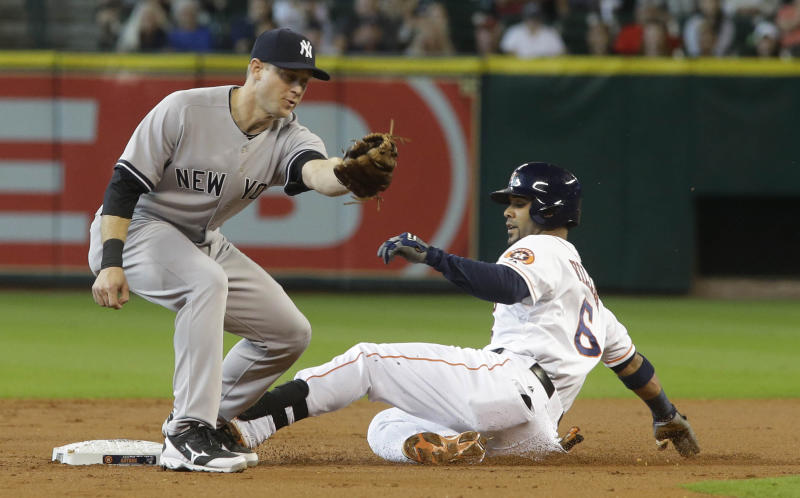 Houston Astros' Jonathan Villar is safe on a double ahead of the throw to New York Yankees second baseman David Adams during the first inning of their baseball game Sunday, Sept. 29, 2013, in Houston. (AP Photo/Richard Carson)