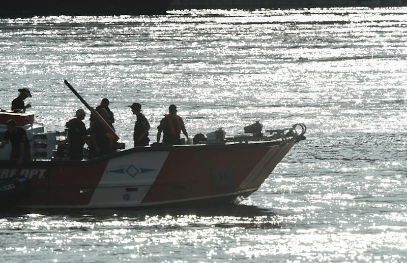 Hungarian rescue workers continue to search for the missing boat passengers