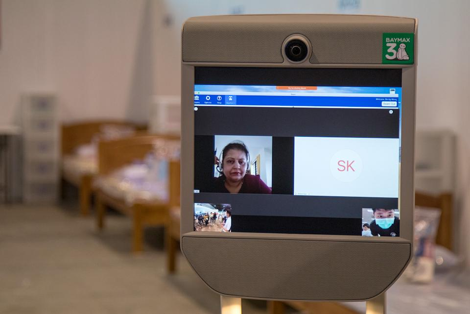 Volunteers who are fluent in patients' native languages can also communicate with them via BeamPro Telepresence Robots. (PHOTO: Dhany Osman / Yahoo News Singapore)